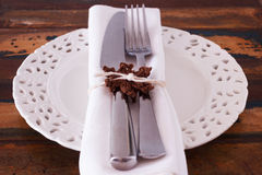 Christmas decoration: White plate serviette fork knife with hand Stock Photography