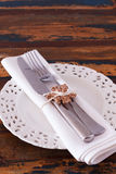 Christmas decoration: White plate serviette fork knife with hand Royalty Free Stock Photos