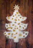 Christmas decoration: white tree of snow decorated with golden m Stock Image