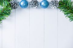 Christmas decoration on white wood with fir branches, cyan ball royalty free stock photo