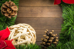 Christmas decoration with wicker ball, pine cones and poinsettia Royalty Free Stock Photos
