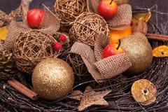 Christmas decoration. Wicker fruit and cinnamon stock image