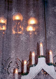 Christmas decoration on window board. Christmas arrangement of electric candles on a wooden window sill creating warm homely atmosphere Royalty Free Stock Photos