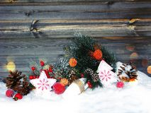 Christmas decoration winter berries and snow on wooden backgroun. Christmas fruit berries apple and decoration with fir branches snow Royalty Free Stock Photos