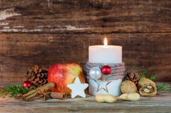 Christmas Decoration With Candle Light, Star Cookie, Red Apple, Nuts And Aromatic Spices Stock Photos