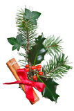 Christmas Decoration With Holly Cinnamon And Bow. Royalty Free Stock Photo