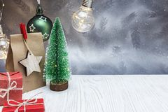 Free Christmas Decoration With Small Green Tree, Paper Gift Bag And R Royalty Free Stock Image - 130046036