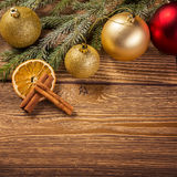 Christmas decoration, on wood background, gold christmas ball Stock Photography