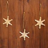Christmas decoration on wood, staw stars Royalty Free Stock Photos