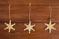 Christmas decoration on wood, straw stars Royalty Free Stock Photo