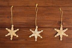 Christmas decoration on wood, straw stars Royalty Free Stock Photo
