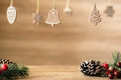 Christmas decoration on wood table with copy space.pine cone,mistletoe and bell ball hanging with blur wood wall background. royalty free stock photography