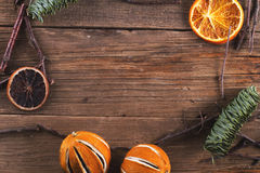 Christmas decoration on the wood texture. Christmas decoration - orange, sticks, pine - on the wood texture Royalty Free Stock Image