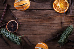 Christmas decoration on the wood texture. Christmas decoration - orange, sticks, pine - on the wood texture Royalty Free Stock Photos