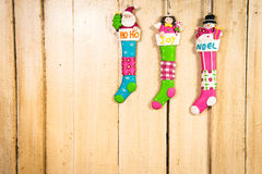 Christmas decoration in a wooden background. Christmas doll looking at the sky, waiting for Santa to come Stock Images