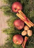 Christmas decoration on wooden background. Christmas decoration apples,cinnamon,nuts on wooden background Royalty Free Stock Photos