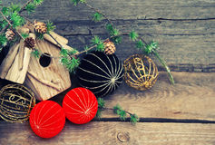 Christmas decoration on wooden background. china style balls. Christmas decoration over rustic wooden background. red and black china style balls and baubles Stock Photography