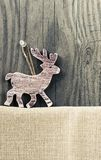 Christmas decoration on wooden background. Christmas decoration deer on wooden background Royalty Free Stock Photos