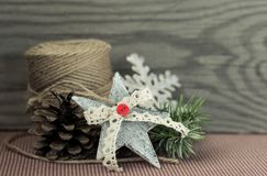 Christmas decoration on wooden background. Christmas decoration jute,cones,star on vintage background Stock Photos