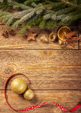 Christmas decoration, wooden background: ornaments, spices, christmas ball and ribbon Royalty Free Stock Image