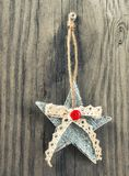 Christmas decoration on wooden background. Christmas decoration  star on wooden background Royalty Free Stock Photography