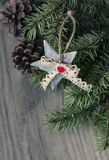 Christmas decoration on wooden background. Christmas decoration star,cone  on wooden background Royalty Free Stock Image