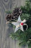 Christmas decoration on wooden background. Christmas decoration star, cone on wooden background Stock Photo