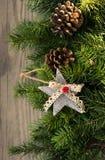 Christmas decoration on wooden background. Christmas decoration star,cone on wooden background Royalty Free Stock Photo