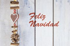 Christmas decoration on a wooden background with text in Spanish `Feliz Navidad`. Christmas decoration on a wooden background with text in Spanish `Feliz Navidad Stock Photo