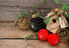 Christmas decoration on wooden background. Vintage christmas decoration over rustic wooden background. red and black china style balls and baubles Royalty Free Stock Photography