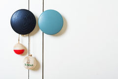 Christmas decoration with wooden balls. On white door Royalty Free Stock Images