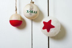 Christmas decoration with wooden balls. On white door Stock Photos