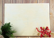 Christmas decoration. A wooden board with Christmas decorations and copy space Royalty Free Stock Photo