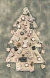 Christmas decoration: wooden carved tree decorated with gingerbr Royalty Free Stock Photos