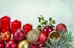 Christmas decoration on wooden tray with red candles Royalty Free Stock Images