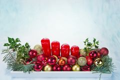 Christmas decoration on wooden tray with red candles Stock Images