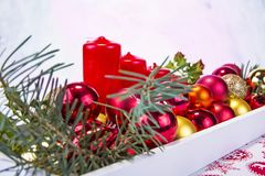 Christmas decoration on wooden tray with red candles Royalty Free Stock Image