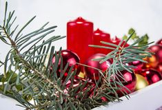 Christmas decoration on wooden tray with red candles Stock Photos