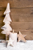 Christmas decoration:wooden tree,stars,candle and snow on wooden Stock Photos