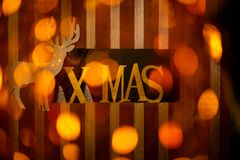 Christmas decoration with word xmas, reindeer and trees stock photo