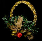 Christmas decoration. Christmas wreath with decorations, on a black background Stock Photos