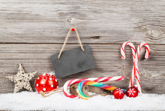 Christmas decoration with xmas canes. Over wooden background royalty free stock photography