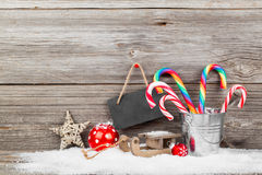 Christmas decoration with xmas canes. Over wooden background stock images