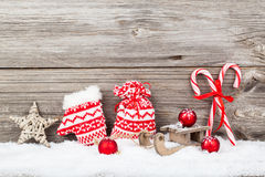 Christmas decoration with xmas canes. Over wooden background royalty free stock photo