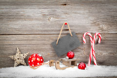 Christmas decoration with xmas canes. Over wooden background royalty free stock image