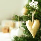 Christmas decoration on Xmas tree Stock Photos
