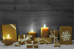 Christmas Decoration With Yellow Candles, Presents And Snow Royalty Free Stock Photo