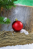 Christmas Decoration on a Yule Log in Snow Stock Photo