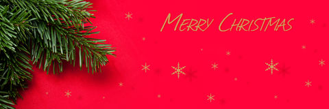 Christmas decorationChristmas card with christmas tree en red background Royalty Free Stock Photos