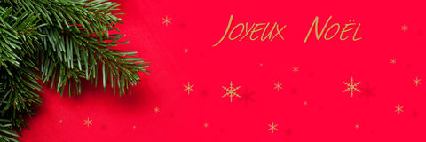 Christmas decorationChristmas card with christmas tree en red background Stock Photo